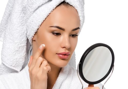 Woman applying night cream